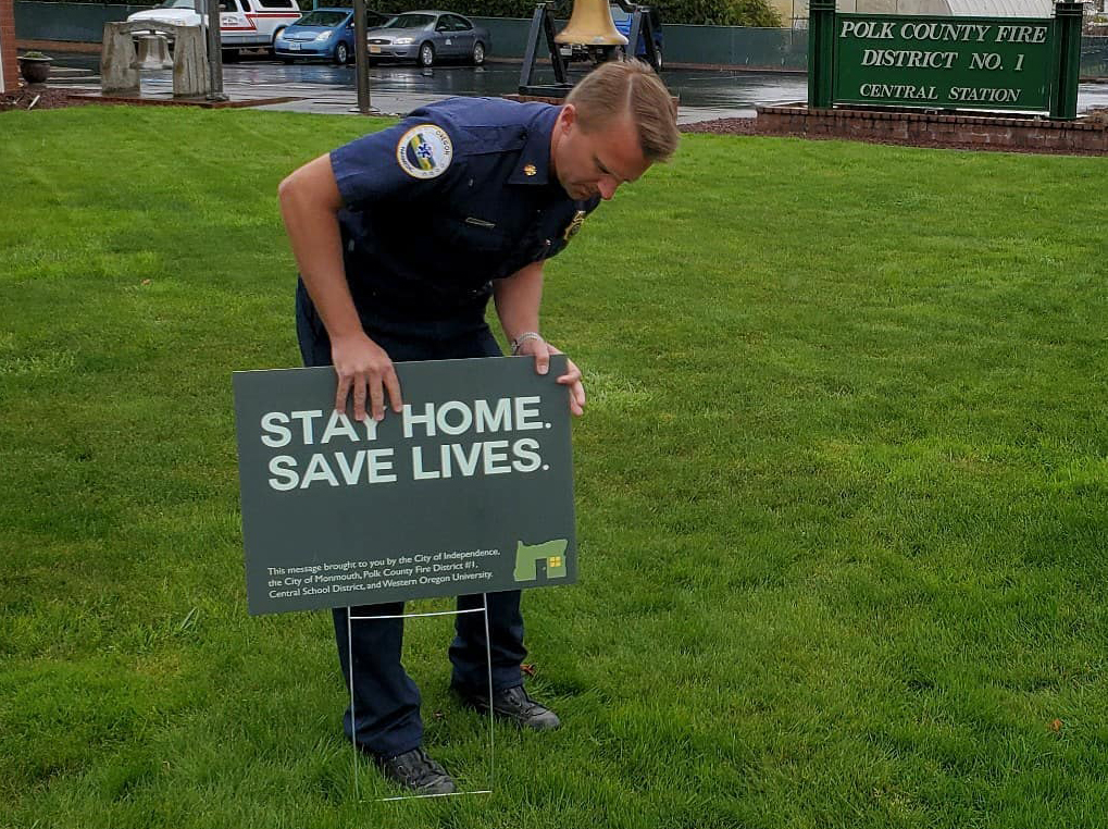 Chief Stange installs yard sign